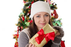 Woman in fur hat and mitten holding Christmas present Stock Photography
