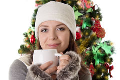 Woman in fur hat and mittens with mug Stock Photography