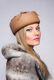 Woman fur hat retro. Beautiful young blonde woman fur hat retro Royalty Free Stock Image