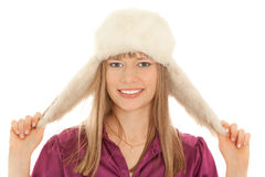 Woman in fur hat smiling Stock Photography