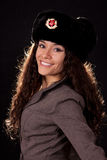 Woman with fur hat smiling Stock Image