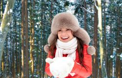 Woman in fur hat with snow over winter forest stock images