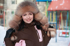Woman in fur hat in winter Stock Photos