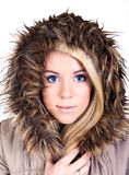 Woman with fur hood. A woman wearing a fur hood, isolated on white background Stock Photo