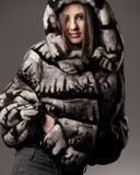 Woman in fur jacket with hood Stock Photo