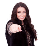 Woman in fur jacket pointing Stock Photos