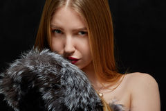 Woman with fur. Luxury woman with fur on black background Stock Image
