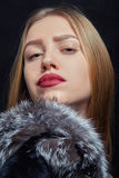 Woman with fur. Luxury woman with fur on black background Royalty Free Stock Photos