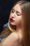Woman with fur. Luxury woman with fur on black background Royalty Free Stock Image