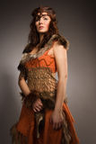 Woman in a fur suit of the amazon Stock Images