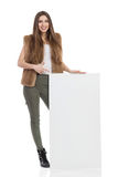 Woman In Fur Vest Pointing And Presenting Stock Photos