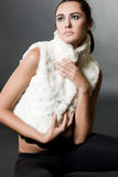 Woman in fur waistcoat Stock Photo