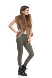 Woman In Fur Waistcoat And Khaki Pants Side View Stock Photography
