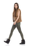 Woman In Fur Waistcoat Walking And Looking At Camera Side View Stock Photography