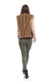 Woman In Fur Waistcoat Walking Rear View  Royalty Free Stock Photo