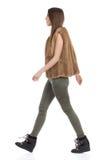 Woman In Fur Waistcoat Walking Side View Stock Photography