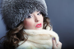 Woman in fur winter coat. A beautiful fashion model a winter coat Royalty Free Stock Photo