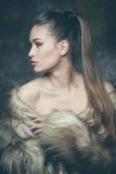 Woman with fur Stock Images