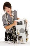 Woman furious with computer. Business woman getting furious with broken computer Royalty Free Stock Images