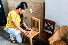 Woman in furniture store buying chair Royalty Free Stock Photos