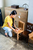 Woman in furniture store buying chair Royalty Free Stock Photography
