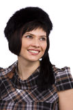 Woman in furry black hat. Royalty Free Stock Images