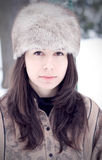 Woman with furry cap Stock Images