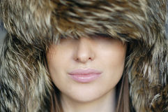 Woman in the furry hat Stock Photos