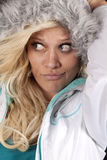 Woman in furry hat look side Stock Photography