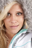 Woman in furry hat looking Royalty Free Stock Images