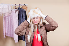 Woman in furry hat thinking what to wear Royalty Free Stock Photos