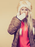 Woman in furry hat thinking what to wear Stock Image