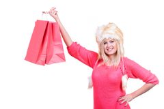 Woman in furry winter hat holding shopping bags. Clothing, seasonal sales and accessories concept. Woman in warm furry winter hat holding shopping bags Royalty Free Stock Images
