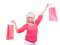 Woman in furry winter hat holding shopping bags Stock Images