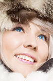 Woman in furs with blue contacts. Beautiful woman in furs with blue contacts Stock Photos