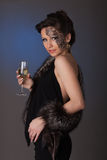 Woman in furs with a glass of champagne. stock photos