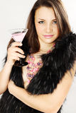Woman in furs  holds Martini Royalty Free Stock Images