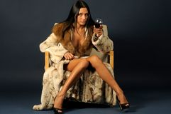 Woman in furs witn wine. Stock Photo