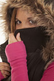 Woman fury hood and pink hide Stock Images