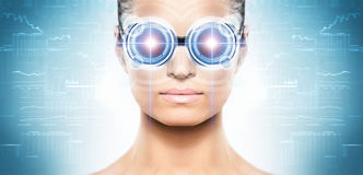 A woman from future with a laser hologram. Young and attractive woman from future with the laser hologram on her eyes (collage about eye scanning technology stock images