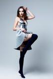 Woman in futuristic creative metallic costume Stock Images