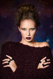 Woman with futuristic make-up Stock Photography