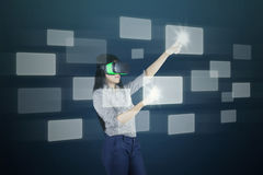 Woman with futuristic screen and VR headset Stock Photos
