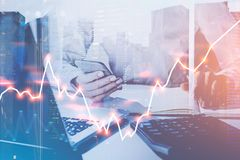 Woman with gadgets in office, forex graph Stock Image