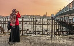 Woman at Galata bridge,Istanbul Stock Photo