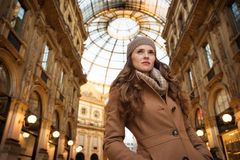 Woman in Galleria Vittorio Emanuele II looking into distance Stock Photo