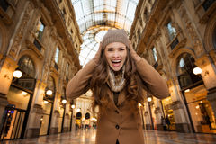 Woman in Galleria Vittorio Emanuele II rejoicing start of sales Stock Photo