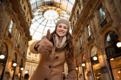 Woman in Galleria Vittorio Emanuele II showing thumbs up Stock Image