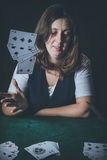 Woman gambling cards Stock Images