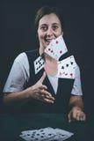 Woman gambling cards Stock Image